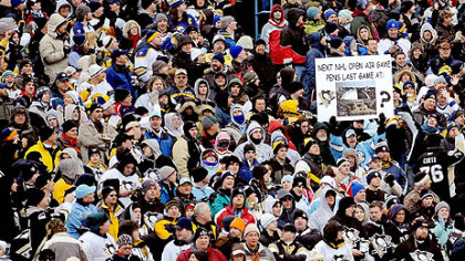 A Pittsburgh fan holds a sign suggesting the Penguins play an open-air game at Mellon Arena before they move into their new building.