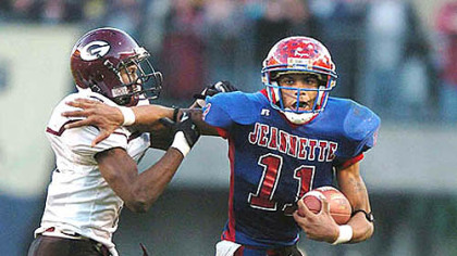 Nov. 24, 2006: Pryor tries to fend off Greensburg Central Catholic&#039;s Chris Hayden-Martin in the WPIAL Class AA championship game at Heinz Field. Jeannette won, 24-14.