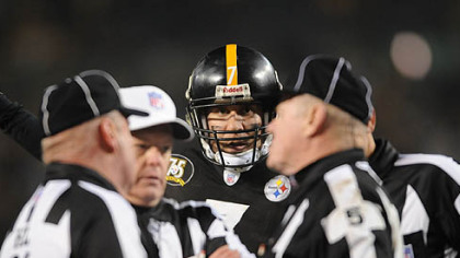 Roethlisberger listens in as referees confer before awarding the Steelers a touchdown. (Jan. 5, 2008)