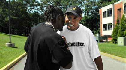 Hines Ward greets Santonio Holmes as they arrive  at St. Vincent College for the start of training camp.