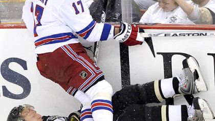 Rangers Brandon Dubinsky topples Penguins Marian Hossa against the boards.