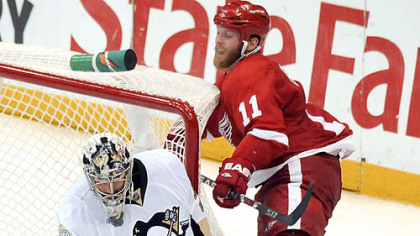 Marc-Andre Fleury makes one of his 55 saves as the Red Wings' Dan Cleary is called for goaltender interference in the second overtime of the Stanley Cup final last night in Detroit.