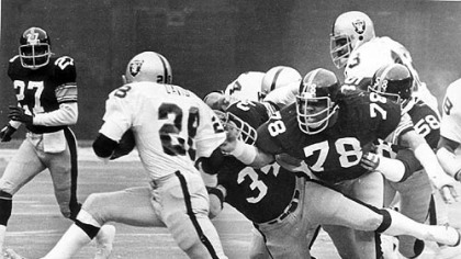 Andy Russell (34), Dwight White (78) and Jack Lambert (58) collar Clarence Davis after a 7 yard gain in this 1976 photo.