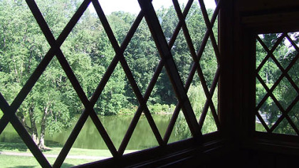 A large window on the second-floor of the Canopy Cathedral treehouse offers visitors a view of the Italian water garden.