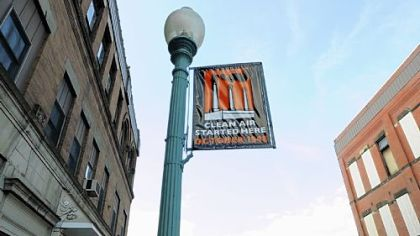 Flying above McKean Avenue, a banner commemorating the 1948 inversion.