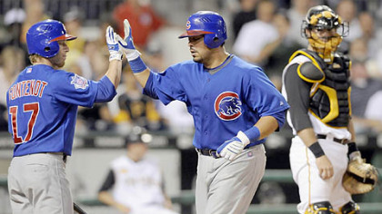 The Cubs' Geovany Soto is congratulated by teammate Mike Fontenot in the sixth inning after hitting a home run against the Pirates last night.
