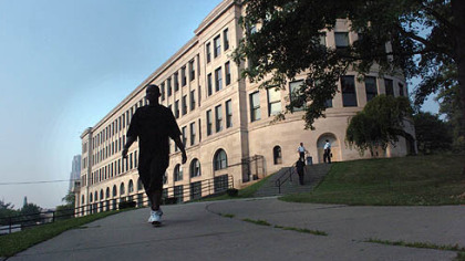 A student walks from the Centre Avenue side of Pittsburgh&#039;s venerable Schenley High School.