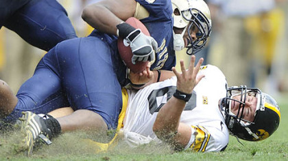 Pitt&#039;s Tony Tucker wrestles the ball from Iowa&#039;s Jake Christensen late in the Panthers&#039; 21-20 win Sept. 20.