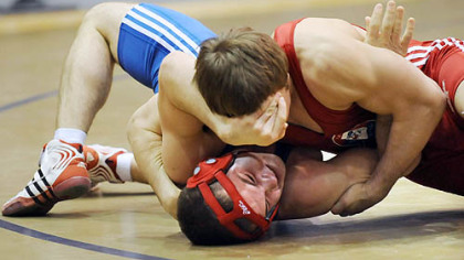 WPIAL All-Star Adam Harold, bottom, of North Hills, battles Wisconsin's  Cody Friemoth.