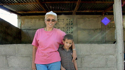 Donna Tabor in 2006 with Jesus Mayorga, for whom she obtained free medical care to correct a potentially fatal heart defect.