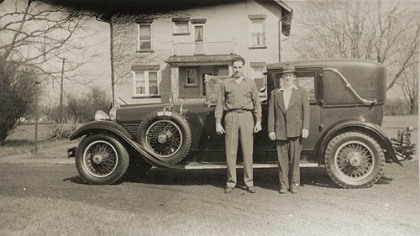 Vernon Regal, right, with the family&#039;s Rolls Royce that he restored. Man on left is unidentified.