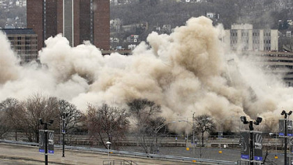 The Downtown landmark collapses in a cloud of dust and rubble.