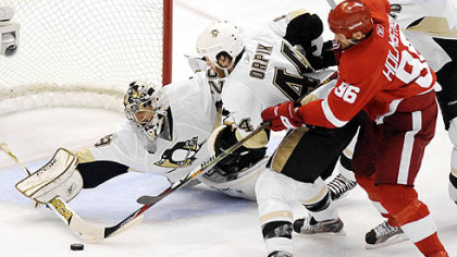 Marc-Andre Fleury makes a save in front of the Red Wings' Tomas Holmstrom.