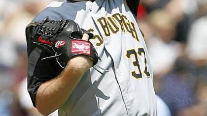 Pirates starting pitcher Phil Dumatrait wipes his face after the White Sox's Jermaine Dye's solo home run in the third inning in Chicago. Dumatrait gave up nine runs in five innings.