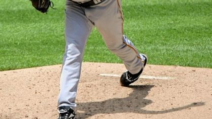 Pirates' starting pitcher Zach Duke delivers against the Colorado Rockies at Coors Field.