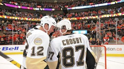 Ryan Malone and Sidney Crosby bask in the Penguins' series sweep of Ottawa last night at Scotiabank Place.
