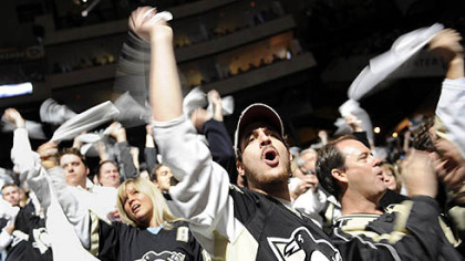 Penguins fans cheer on their team as they take on the Flyers Sunday.