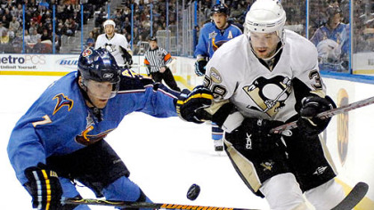 Atlanta's Mark Popovic, left, and the Penguins' Jeff Taffe vie for the puck.
