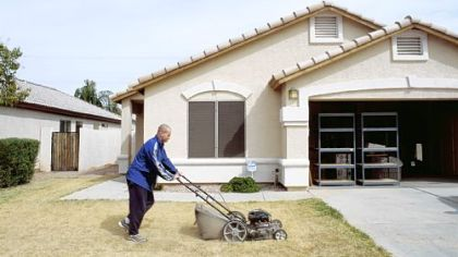 Love of lawn: Greg Stimac photographed this image in Chandler, Ariz.; it&#039;s part of his &quot;Mowing the Lawn&quot; series.