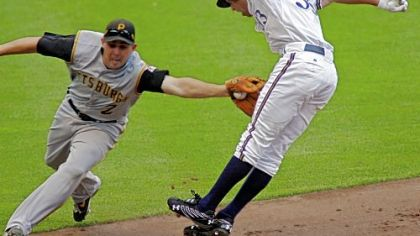 Pirates shortstop Jack Wilson tags out the Brewers' Gabe Kapler, who was caught in a run down in the sixth inning.