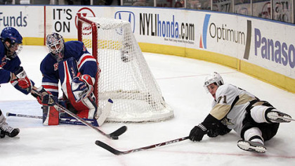 New York Rangers goalie Henrik Lundqvist and Paul Mara, left, defend the net as the Penguins'' Evgeni Malkin (71) reaches out for the puck during the first period of their NHL hockey game at Madison Square Garden in New York last night.