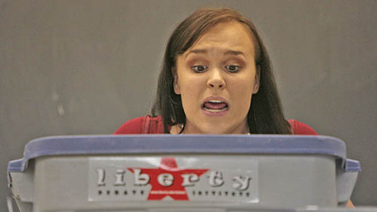 Jackie Poapst, 19, a history major at Liberty University of Virginia, reads several cards of information as quickly as possible breaking only for a quick breath of air as she delivers her team's rebuttal remarks.