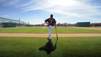 Pirates manager John Russell watches pitchers during workouts at Pirate City.