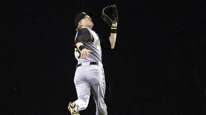 Pirates centerfielder Nate McLouth tracks down a deep fly off the bat of San Diego Padres' Luis Rodriguez in the first inning of last night's game in San Diego. (AP Photo/Lenny Ignelzi)