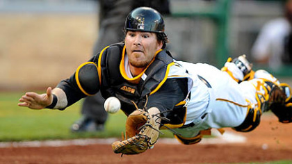 The Pirates' catcher Ryan Doumit makes a diving attempt on bunted ball by the Diamondbacks' pitcher Brandon Webb in the second inning tonight.