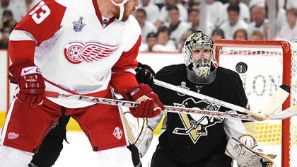 Penguins goalie Marc-Andre Fleury makes a save on a shot by the Red Wings' Johan Franzen in the second period.
