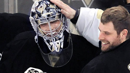 Backup goalie Ty Conklin congratulates Marc-Andre Fleury after yesterday&#039;s 2-0 shutout victory against the Rangers at Mellon Arena. Fleury made 26 saves to improve to 6-0 in the playoffs.