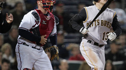 The Pirates&#039; Nate McLouth (13) and Atlanta Braves catcher Brian McCann watch McLouth&#039;s three-run home run in the eighth inning of their MLB baseball game last night in Atlanta.