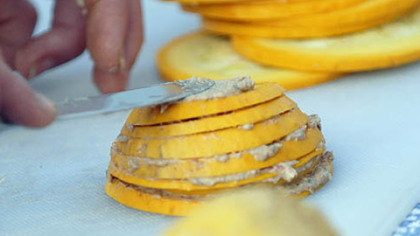 Laura Miller prepares a Summer Stack, squash layered with olives and goat cheese.
