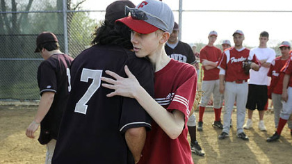 John Challis gets a hug from Beaver's Al Torrence after the two teams played on April 24.