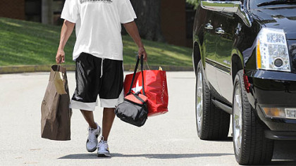 Hines Ward carries his stuff into the dorm at St. Vincent College at the start of training camp.