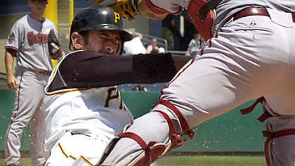 Pirates corner infielder Jose Bautista, left, is tagged out by Diamondbacks catcher Miquel Montero in the sixth inning.
