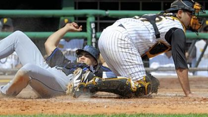 Mets' Carlos Beltran slides safely into home plate against Pirates' Raul Chavel in the fourth inning.