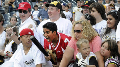 Amal Chabra, 12, of Sewickley, reacts after getting a bat from Pirates player Jack Wilson after the Pirates' last home game.