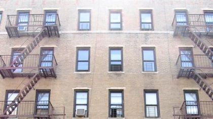 The yellow brick apartment building where Pirates No. 1 draft pick Pedro Alvarez and his family lives on Ellwood Street in Washington Heights, New York City.