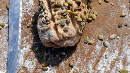 A Honey Wheat Loaf with roasted pumpkin seeds, by Josh Tonies.