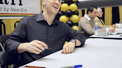 Jason Bay happily signs autographs along with Neil Walker and Bob Friend at PirateFest at the David L. Lawrence Convention Center last night. But he wasn't happy that Pirates management didn't make any big moves in the offseason.