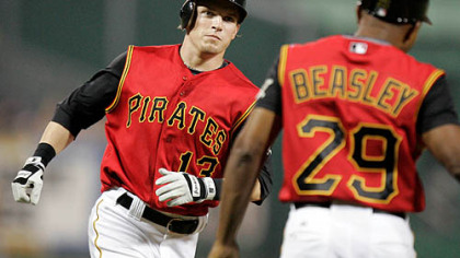 Nate McLouth, left, rounds third to greetings from coach Tony Beasley (29) after hitting a fifth-inning solo homer off Milwaukee Brewers    pitcher Dave Bush in a baseball game at PNC Park last night.