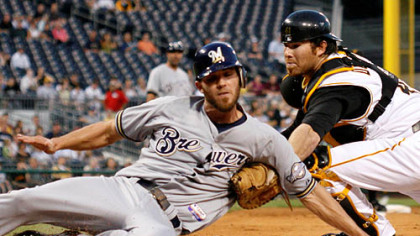Ryan Doumit, right, tags out Milwaukee Brewers' J.J. Hardy who attempted to score from third on a grounder by Brewers' Ryan Braun during the third inning of last night's baseball game at PNC Park.