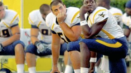 West Virginia's Gino Gradkowski, left, and P.J. Shirdan watch the clock wind down yesterday at East Carolina, where the No. 8 Mountaineers were upset.