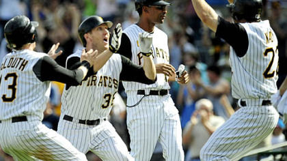 Nate McLouth, Jason Bay and Xavier Nady celebrate Sunday after Bay hit the winning single to score Chris Gomez in the bottom of the 11th inning to beat the Chicago Cubs 6-5 at PNC Park.