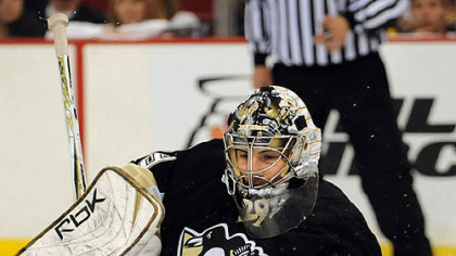 Penguins Marc-Andre Fleury makes save against the Flyers in the second period.