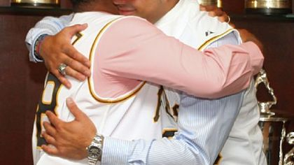 Pedro Alvarez embracing his father after signing his contract yesterday at PNC Park.