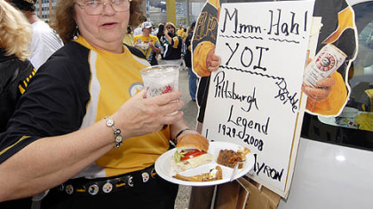 "Steelers' fan Barbara Cord, of Baldwin Borough, outside Heinz Field on Sunday, is a veteran tailgater, having begun her ""career"" in 1959 when the team played at Pitt Stadium. Her friends says she makes the best haluska. The Myron Cope cardboard standup belongs to friend."