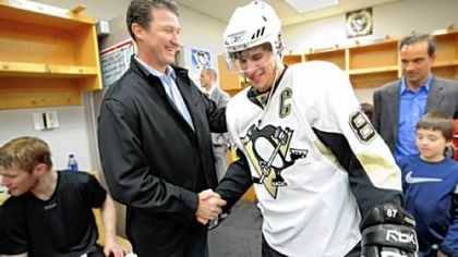Owner Mario Lemieux, left, worked his way through the victorious Penguins locker room in the moments after they completed their sweep of the Senators last night in Ottawa == the Penguins' first series victory since 2001.