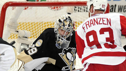 The Red Wings' Johan Franzen scores a goal on Penguins Marc-Andre Fleury in the second period.